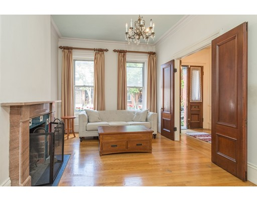 Quintessential brownstone on tree-lined K Street, one of the most coveted locations in South Boston! This property offers high ceilings, period moldings, 4 bedrooms, parking, and a back deck that leads to private garden. On the parlor level is the kitchen, living, dining room and a half bath. 2nd floor offers 2 large bedrooms and smaller 3rd bed. The master suite on the top level boasts many skylights and cathedral ceilings. It could easily be divided up to add an office or additional bedroom. The home currently has 1 parking spot but could be permitted for a 2nd spot. Fully renovated in 1999, it has beautiful hardwood floors and AC but is ready for updating and offers many possibilities. The garden level has full ceiling height, a bathroom and separate egress, creating the opportunity for a 2nd unit with an added parking space. Ideally located on a quiet cobblestone street, walkable to pristine beaches, Castle Island, Starbucks, and many shops/restaurants on E Broadway!