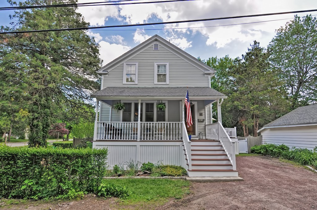 Gardener's delight in Alfred Drowne! Situated on a corner lot sits this adorable 1915 colonial. Spacious open porch with bead board ceiling, a mahogany deck off the kitchen leads you to a fenced yard with plantings galore. Inside is a stunning white kitchen with soapstone counters, stainless appliances and a gray wood tile floor. Remodeled second floor bath with subway tile shower and tile floor. Original wood floors throughout the first and second levels. Recessed lighting, crown moldlings, picture framed foyer floor, original staircase, built-ins. Neat wine tasting space in walkout basement. Amazing Barrington schools, close to bike path, walk to three neighborhood beaches !