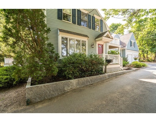Located on a dead end this stunning location is on a quiet side street that you may not even know existed! This expanded colonial with spacious rooms and a great floor plan on the banks of the Merrimac with a 45 -foot dock is the home you have been waiting for. Originally built in the 1850's and reimagined in 1993 with a large addition and oversized 2 car garage; the unobstructed water view from most of the rooms make this your waterfront oasis. The expansive eat in kitchen with center island and breakfast nook features an original fireplace is a great gathering place opening to a large deck overlooking the large. Adjacent to the kitchen is a fireplaced family room and first floor office with built ins. The master suite with a fireplace and master bath are both generously proportioned with fantastic views. Enjoy your morning coffee or evening cocktail while you watch the boats cruise by, the eagles soar, and waterfowl play from your private waterfront patio. Truly a very rare offering!