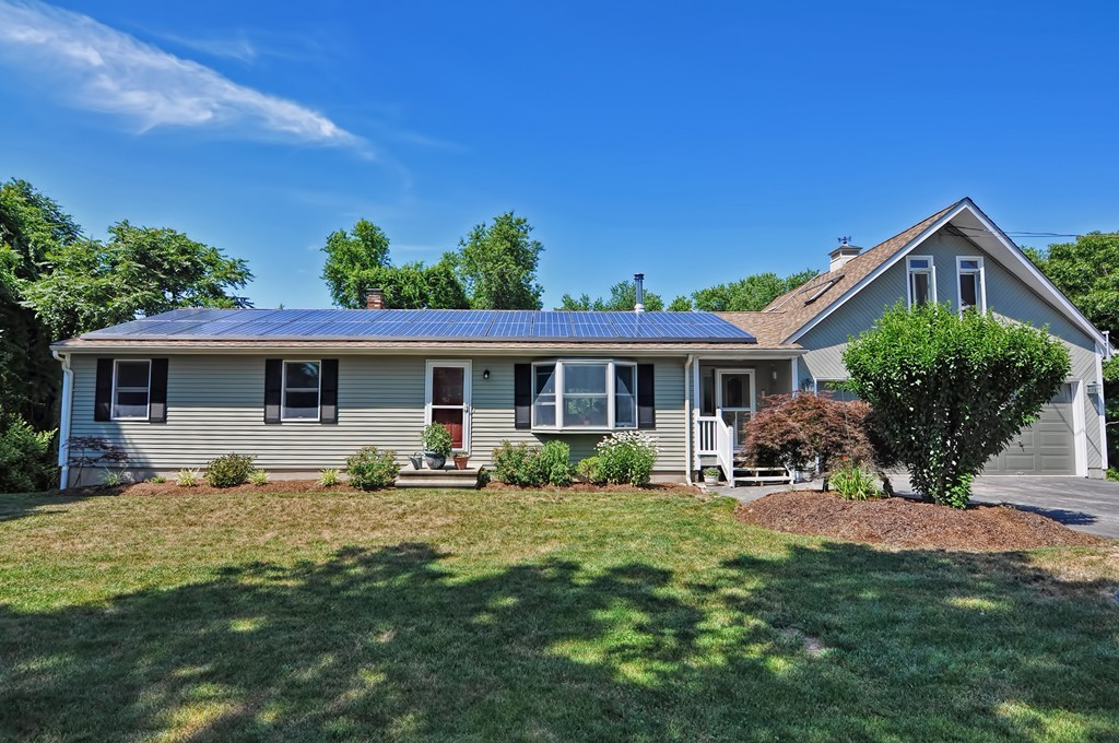 This is your opportunity to live in a desirable and convenient South Rehoboth location and all on one floor! You could live very efficiently on one level and have plenty of room for guests or potential in-law with the finished lower level which features a second kitchenette, full bath, family room and possible other bed or office. This incredible home has been well cared for and has had many recent updates including a new granite kitchen with beautiful freshly painted cabinets, custom back splash and stainless appliances. There is an incredible bonus room that was completed weeks ago above the garage with skylights, new flooring, fresh paint and propane stove. All appliances and both wood/propane stoves included! Water filtration system, newer roof, heating system and well. Solar installed in 2017 and makes home more efficient.This incredible home is set 1.5 acres with a private pond and small pen and shed for a potential gentleman's farm for chickens and or goats!