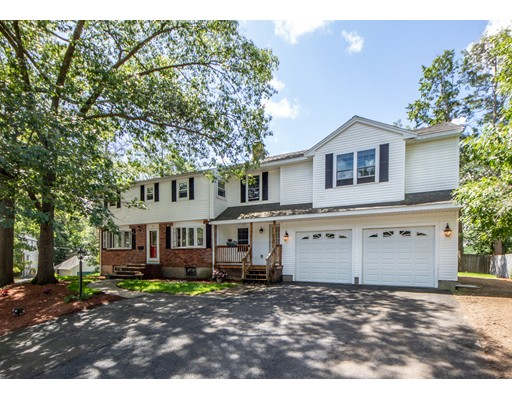 This large family home in the Greenlodge section of Dedham exemplifies pride of ownership through out. The open floor plan with lots of windows and natural light features a chef's kitchen with state of the art appliances and beautiful breakfast bar. The kitchen has direct access onto the deck which overlooks a large level professionally landscaped yard. This spacious family room has been wired for surround sound, has a working fireplace, 2 Jacuzzis and beautiful bay window. There is 2 car garage with direct access to the house and a separate side entrance that leads to a storage or mudroom and brand ne half bath. The HUGE master bedroom has 2 walk in closets,High Ceilings,sliders to a small veranda as well as a gas fireplace.The other 4 large bedrooms are recently painted and have plenty of closet space. There is also a laundry room on the second floor. There is another partially finished room in the basement that would be perfect for a home gym. This home will not disappoint!!