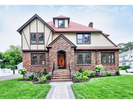 Elegance and Beauty gives this home a commanding presence!  Perfectly sited on Picturesque W.Roxbury Parkway and surrounded by plush grounds. This Center Entrance Colonial/Tudor crafted by a masterful eye is like no other. Enjoy state of the art kitchen with SS Bosch appliances, entertainment size island, amazing lighting, enhanced by crown molding & beamed ceilings, all overlooking family room, you'll never miss a beat at a party. fireplace living room overlooks dining room with slider out to stone patio with illuminated glass stairs for evening ambiance. sun splashed 1st floor office with french door to stone balcony & 1/2 bath. 4 Luxurious bedrooms with 2 master on suites, closets galore all around. convenient 2nd floor laundry room w/linen closet. Finished lower level play room, storage area and for pet lover's a perfect dog bath/shower :)  2 car garage with stairs to loft area, convenient location, walk to T, Rail and shops. Graced by so much more, Don't miss out!