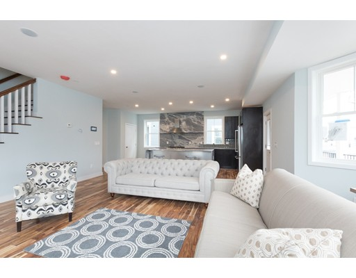 Welcome home to Vicinity Place of Roslindale.  One of six brand new townhouse-style condominiums tucked away on Granfield Ave. Greeted by private one-car-under garage parking, you will notice an attention to detail at every turn. First floor is completely open-concept kitchen / living / dining, and ½ bath, light and bright with details galore. Kitchen finished Kitchenaid appliances, Franke faucets, soft-close cabinets with tons of storage, Calacatta Halian Granite counters and backsplash that have been hand-picked by builder, straight from Italy. Second level of living offers three bedrooms, complete with master suite and laundry hook-ups. Gas heat and central air controlled by Nest thermostats andRecessed lighting throughout the unit. This unit also has a generous amount of outdoor space, with three private decks.