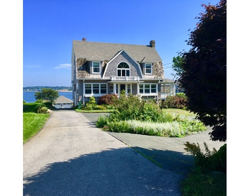 """Oceanfront Classic!""""Rocky Place by the Sea"""" Overlooking Sandy Bay & Town of Rockport on nearly 1 acre of land. This 3 Bedroom, 3 1/2 Bath Colonial Home is full of character & charm! It offers a Living Room with Marble Fireplace, Formal Dining Room,  Study and Ocean View Kitchen with wrap around porches to enjoy the salty summer breezes. Basement has been updated and finished as a family/rec room area for the kids! Beautiful landscaped grounds both in front of home and in back leading down to oceans edge. Added bonus of a 2 car stone garage with many possibilities!! Come enjoy the sunrises from this quintessential New England beauty! First showings at Open House Sunday August 19th 12 - 2."""