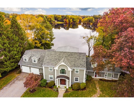 STUNNING WATERFRONT PROPERTY ON UPPER MYSTIC LAKE! Meticulously maintained home with mature plantings and private dock. Thoughtfully designed for today's savvy buyer. Featuring a large fireplaced family room with cathedral ceilings & an oversized kitchen with a top of the line SS appliance package & granite counters, perfect for entertaining. The formal dining & living room complete the 1st floor. Upstairs houses a large master suite with walk in closet, full bath with shower and separate Jacuzzi. 3 other bedrooms, 2 full baths and laundry finish the 2nd floor. The upper level is just waiting for an inspiring artist to set up a proper studio! Plenty of natural light and dramatic water views from almost every room! Extremely peaceful and quiet location within a short drive to downtown, where you'll find plentiful boutiques, coffee shops, restaurants and the commuter rail to North Station. Within the Ambrose Elementary school, easy access to major highways and only 7 miles to Boston.