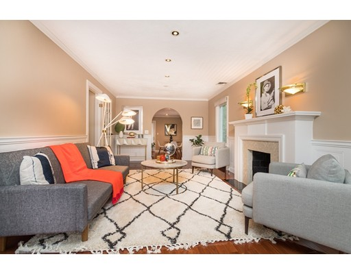This gracious, thoughtfully updated Garrison Colonial in Brookline's coveted South Brookline neighborhood has undergone a seamless two-story addition, perfect for entertaining or family living. The versatile main level offers a lovely living room with wainscoting and a decorative fireplace; a modern eat-in kitchen with breakfast bar, granite, and stainless steel appliances; a powder room; and an expansive open-plan family room and dining room leading to a landscaped patio and backyard. The expansive upper level---distinguished by a dramatic master suite with cathedral ceilings, double closets, and a full bath---offers four generous bedrooms, a second full bath, and a home office or nursery, all on one level. Wonderful walkout finished lower level. Numerous upgrades including 200 amp electric, refinished floors, driveway, and a storage shed. House has 3 zones gas heat plus C/AC and wall A/C. Outstanding location near shops, restaurants, the commuter rail, Baker School, and Hynes PG.
