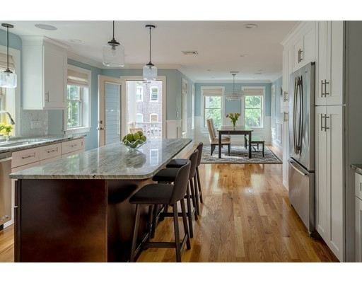 This elegant home is three years young and in the heart of Jamaica Plain, in a private setting highlighted by a Boston landmark antique gaslight.  Built in 2015 with a true attention to detail, wainscotting in the LR and DR, crown molding throughout and decoratively inlaid HW floors. Situated on the top two floors of a two-unit association, this condo boasts a welcoming landing with a wide open LR, featuring a gas fireplace. The spacious, sunny kitchen is outfitted with Jennair appliances and an expansive island.  There is a large dedicated dining area off the kitchen as well as a sunny deck with 4 roomy BR's, 3 full baths and plenty of storage. Dual zones heat/air with Nest thermostats. Built-in sound system throughout. You'll find two deeded parking spaces right outside your back door. The association offers a common patio and garden. Close to everything that makes JP great place to call home. Walkable to the Pond, Whole Foods, countless dining options, and the Stony Brook T stop.
