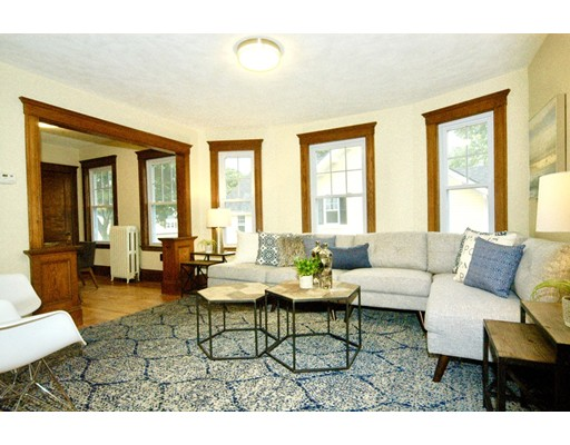 Welcome home to 133 Maple Condos.  Beautiful and efficient modern condos with a sleek kitchen renovation and luxurious bathrooms while restoring the exquisiteness of natural woodwork. Versatile bi-level layout, private master suite on top level with sitting area, nursery or office with skylights galore.  Four season sun room to admire the fall foliage from above.  Under 8 min walk to fancy downtown style dining to NYC's standard bagels and cafes.   Commuter rail, post office and Roche Bros. market are all a short walk too.  Association has huge lush back yard, 9,400+ sqft lot for possible expansion.  Buyers due diligence.  Also listed as a multifamily.  Open House Sunday 12-1pm
