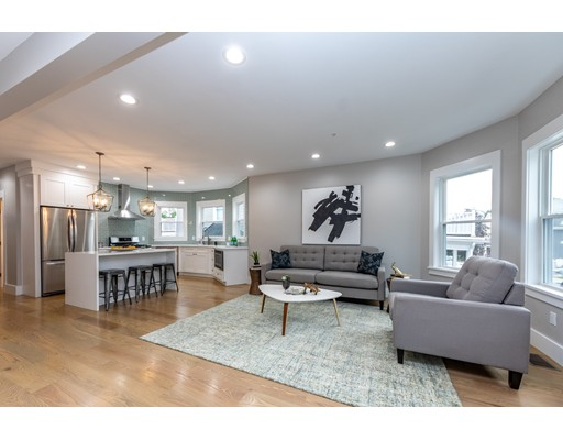 """STUNNING BRAND NEW 2018 RENOVATION with all high-end designer finishes! 75 BRADFIELD offers 3 gorgeous sun-splashed condominiums in a central Roslindale location where you are perfectly located between Roslindale Village & West Roxbury Center! Unit #1 offers a private entrance with a dynamic open concept floor plan which is perfect for entertaining and everyday living! Your wish list is complete with a Chef inspired kitchen with custom shaker soft close cabinets, Supra White quartz countertops, glass tile backsplash, high-end LG Appliances & 5 burner gas stove!  Fine details include: sleek wood work, tall ceilings, recessed LED lighting, Harvey windows, oak wood floors, NEST thermostats, 3BD!, private laundry room (washer/dryer included!), high efficiency heating/cooling systems, """"on demand"""" hot water, 1 car GARAGE parking & tons of storage space in the basement!!  Nice level common yard space & rear deck! NEW: KITCHENS, BATHS, PLUMBING, WIRING, WINDOWS, ROOF, HARDI-PLANK SIDING & MORE"""