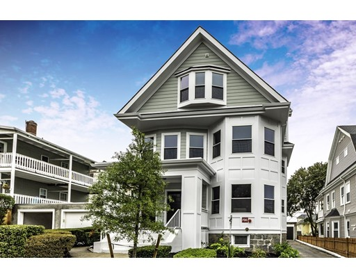 """STUNNING BRAND NEW 2018 RENOVATION with all high-end designer finishes! 75 BRADFIELD offers 3 gorgeous sun-splashed condominiums in a central Roslindale location where you are perfectly located between Roslindale Village & West Roxbury Center! Unit #2 offers a dynamic open concept floor plan which is perfect for entertaining and everyday living! Your wish list is complete with a Chef inspired kitchen with custom shaker soft close cabinets, Supra White quartz countertops, glass tile backsplash, high-end LG Appliances & 5 burner gas stove!  Fine details include: sleek wood work, tall ceilings, recessed LED lighting, Harvey windows, oak wood floors, NEST thermostats, 3BD!, private laundry room (washer/dryer included!), high efficiency heating/cooling systems, """"on demand"""" hot water, 1 car GARAGE parking & tons of storage space in the basement!!  Nice level common yard space & rear deck! NEW: KITCHENS, BATHS, PLUMBING, WIRING, WINDOWS, ROOF, HARDI-PLANK SIDING & MORE"""