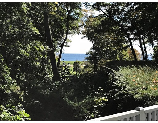 Ocean views from this wonderful Cape Cod style home with deeded rights to private beach in desirable Paine Avenue. Enjoy single level living but with a sitting area and 2 additional bedrooms and baths on second level. Open floor plan on first floor, large welcoming foyer, living room with fireplace, nice size dining room, bright kitchen with skylights, glass surrounded sun room and half bath with laundry. There is also a large private first floor Master Suite with a generous walk in closet and large bath with jacuzzi tub. The property is beautifully landscaped with a brick and stone walkway, private fencing, grassy area, lovely trees and shrubs and a 2 car garage with storage. Just a short distance to the commuter rail and the town of Beverly Farms.