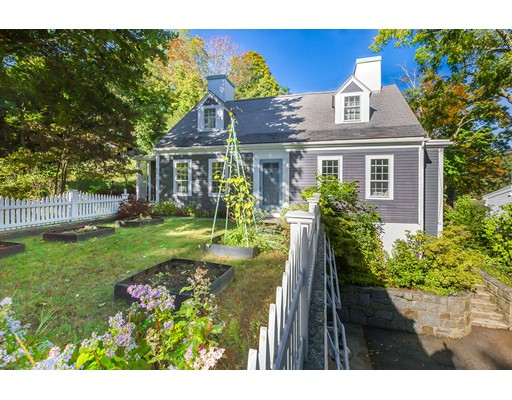A rare opportunity to own a charming 6-bedroom, 3.5-bath Annisquam home near Lobster Cove, suitable as a primary year-round home or vacation home. Nestled in on a quiet, serene, and private road, and with water access to tidal Lobster Cove, this antique cape is both charming and spacious, with three levels of living space, multiple  outdoor dining and seating areas, five fireplaces, stunning  gardens, a native granite patio, and a three-season porch. The first-floor master bedroom has an en-suite bath with a clawfoot tub and separate shower. A second  bedroom, the garden bedroom, with fireplace, en-suite bath and sauna, can be accessed via a separate private entrance or through the house. Four additional bedrooms and full bath are found on the top floor of this lovely home. Only a 5-minute walk to pristine Lighthouse Beach.