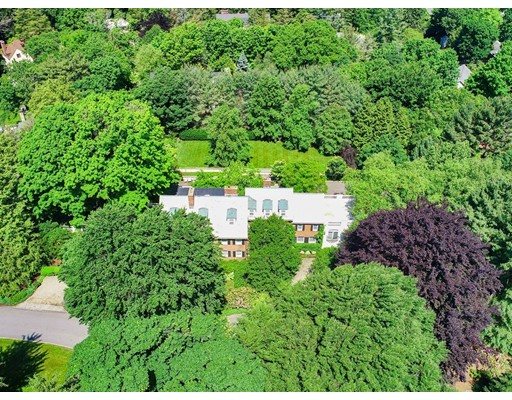 In one of the most sought after locations close to Boston, this idyllic estate property is sited on 1.22 acres of breathtaking grounds in Old Chestnut Hill. Built in 1920, with a European sensibility, this sprawling brick colonial has been updated and expanded over the past 20 years, making it ideal for today's modern family. Welcoming sun-filled foyer leads into an open floorplan w/ both formal and casual living spaces, perfect for entertaining. This residence offers 6 bedroom, 6 and a half baths, 7 fireplaces and multiple rooms with balconies overlooking the spectacular grounds. All 4 levels have multiple terraces leading to outdoors. Lower level has an exercise, playroom, game/pub room,  spa-like hot tub w/ direct access to outdoor pool. Expansive grounds are complimented by a partiere garden, meditation area with pond. Minutes to shops  & restaurants at The Street and Chestnut Hill Square, Chestnut Hill T, Longwood Tennis Club. Short commute to Medical area, Boston & Cambridge.