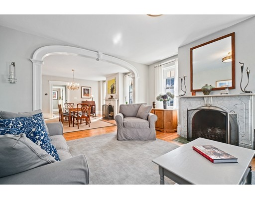 This 1850 Greek Revival located in the heart of historic downtown Newburyport, one block from the restaurants and shops, situated on a quiet, private lot with a one car garage and parking for 6 cars . Renovated while respectfully maintaining original detail, this home exemplifies today's Newburyport! Overlooking a sun drenched family room with a cathedral ceiling, the kitchen has a large pantry, quartz and granite counter tops, white custom cabinetry, hardwood floors, a large center island, a Wolf 48 inch, 6 burner range with griddle and a 42 inch sub-zero fridge. The beveled glass french doors lead to the newly replaced composite deck and into the fenced in yard. The 8 1/2 ft ceilings, the companion Belgian marble fireplaces and timeless center arch makes this space inviting. A period floating staircase in the foyer brings you up to three en-suites. The master en-suite has a fireplace, walk in closet, marble & porcelain bath.  First Showings Sunday 10/21, Open House 11-1.