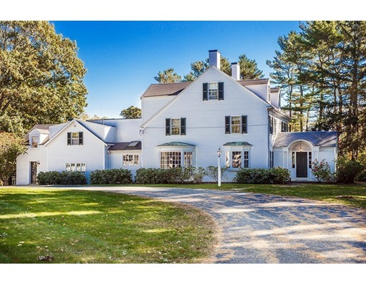 This handsome three-story Colonial is situated on 1.3± acres, in-town, in Beverly Farms and only 5-minutes to West Beach and 1-minute to town and commuter rail to Boston.  The grounds feature a large open lawn, rare for its in-town location, a wonderful in-ground pool nestled off the back patio, and a variety of mature trees creating a wonderful sense of privacy. Set back from the road this c1800 residence offers six bedrooms, and five baths in a unique and peaceful setting.  Original details such as antique hardwood floors, 4 working fireplaces, formal marble entry way give the home rich character.  The kitchen has been updated and there is convenient second floor laundry room. The third floor has two bedrooms and a full bath, suitable for an in-law or au-pair suite. The neighborhood of Beverly Farms offers an array of restaurants and shopping and access to sandy, West Beach for residents.