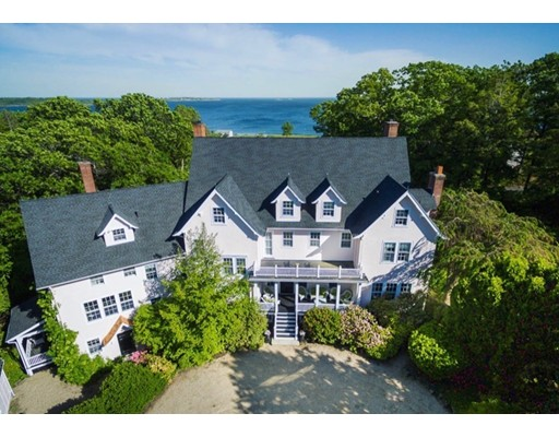 "Magnificent ocean views from this private elevated ""turn of the century"" stucco mansion in the prestigious area of Paine Avenue in Prides Crossing on over 2.5 acres of beautiful landscaping. The three story home is the original Paine House in the Paine Estate and is in excellent condition with 6 bedrooms, 6 bathrooms and 2 additional half baths. The 1st floor has a lovely large entrance hall, living room, library, dining room, large gourmet kitchen, family room with breakfast area and half bath. The 2nd floor has 5 bedrooms, 4 baths and an office. Rooms on the 3rd level include the 6th bedroom. There is a partially finished walk out basement with an art studio and work shop. Also two car detached heated garage. The home has high ceilings, 7 fireplaces, hardwood floors and ocean views from nearly every room. The property is high above the road with walking paths through lovely perennial gardens, specimen trees and shrubs. Property has deeded private beach access."
