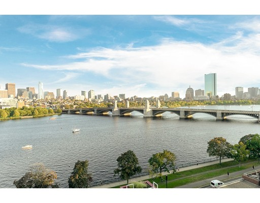 Sprawling 3+ bed residence w/ panoramic views of Beacon Hill, Back Bay & Charles River. Located at Cambridge's premier full-service building, The Esplanade, this 3,600 sq/ft home is perfectly located on the corner of the 9th floor w/ incredible views. Ideal floorplan w/ open living/dining spaces and 3 private bedroom suites. Renovated kitchen w/ breakfast & family room overlooking Charles River & Boston. Formal living room & dining room w/ custom wet bar -- ideal for entertaining. Large master suite w/ private balcony, sitting area, walk-in closet & en-suite bath. 2nd bedroom w/ large closet & en-suite bath. Guest bedroom has private study w/ custom built-ins & ensuite bath. Gracious foyer makes perfect gallery. 2 deeded garage parking & large storage. The Esplanade is one of Cambridge's finest full-service buildings, featuring 24 hour concierge, owner's lounge, gym, indoor swimming pool & guest parking. On the Charles River, The Esplanade is steps to Kendall Square, MIT & Beacon Hill.