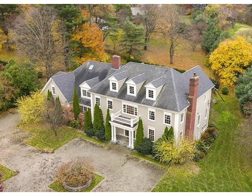 Distinctive Colonial home beautifully sited on 0.69 acres offering three gracious levels of living with well proportioned rooms and architectural detail. Enter to a gracious foyer with sweeping staircase and marble floor. The first floor features classic formal living room with high ceilings and fireplace leading to the dining room with adjacent butlers pantry. The heart of the home is the chef's kitchen with top appliances, walk-in pantry, sun-filled breakfast nook and fireplace. It is open concept to the family room which is oriented to views of the expansive patio and landscaped yard. This level is complete with a spacious home office, large mudroom, two half bathrooms and attached 4 car garage. The second level offers an spacious master suite with two large walk-in closets and a light filled marble en-suite bathroom.There are three additional generously sized en-suite bedrooms, a media room, playroom, office/bedroom & laundry. The finished lower boosts an expansive in-law apartment