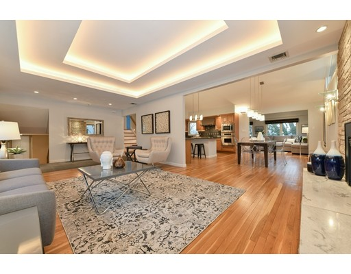 """Welcome, Home to this impressive contemporary, 33 Slocum Road Moss Hill, it's a brilliant blend of space, style, form and 21st C. functionality. Accommodation's include: ~ 2609 SF, 3 levels of living, 9 rooms, 3+bedrooms, 3 full bathrooms, family/media room, sun-room/den w/direct access to a huge yard. Captivating living room with gas fireplace, gallery double tray ceiling w/Juno lightning. Relish in the made-to-order top of the line kitchen, maple cabinets, 42"""" Sub-zero, dacor 6 burner cook-top, pot filler, dacor 30"""" wall oven, microwave & F&P DW, Marvel wine cooler & beverage fridge, granite, Island, nickel tile. En-suite master bedroom. Noteworthy, important features:  cathedral ceiling, skylights, high-end lighting, HW floors, deck, central vacuum system, a/c, gas generator, integrated speakers, 3 car heated & a/c garage w/quarry tile floor, insulation, & irrigation system. Walk to British School, Pond, Laz Anderson Museum, close to Longwood  Medical. Truly, A Special Property!"""