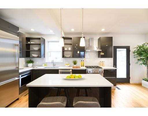 22 White Street Place Residences, completed in 2018, are three luxury three-bed, 3.5 bath single family style homes in Porter Square that define  contemporary living. Close to Davis Square, Harvard University and downtown Boston, the location of these homes is a commuters dream. Each unit features  detailed high end finishes including white oak flooring, Porcelanosa fixtures and Scavolini cabinets. An inviting first floor level offers open concept living and  dining equipped with a gas fireplace. Kitchens are fully-outfitted with Thermador appliances and quartz countertops. On the second floor, each home  features two spacious bedrooms and a full bath. The third floor hosts the master bedroom suite with a spacious private deck, walk-in closet and a master  bathroom, fitted with a freestanding tub and luxurious shower. The finished lower level makes an ideal media or recreation room. The residences come  complete one parking space.