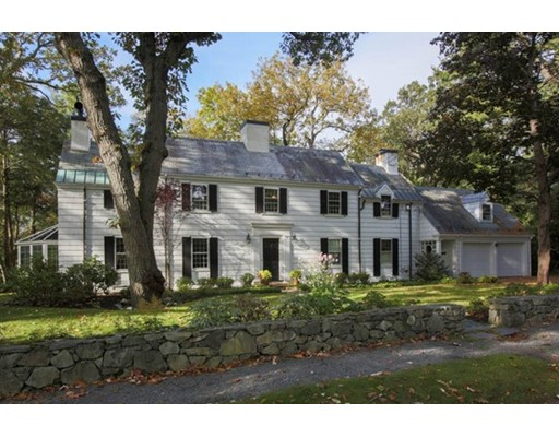 Situated on 1.2 ACRES  in one of Chestnut Hill's premier locations is this beautiful 1939 Shingle-Style Colonial residence with a slate roof on a level landscaped lot bordering conservation land. A welcoming foyer leads to 3,074 square feet of living space. This home features a banquet-sized dining room with built ins with a door to a stone patio. There is a spacious living room with fireplace and built ins, plus a tranquil solarium that was rebuilt in 2008. Open kitchen with quartz counter tops and heated bamboo floors, a fireplaced family room with a door to a lovely deck with lovely views.  There are four bedrooms highlighted by a tranquil master suite with fireplace. 3.5 baths in total, detailed moldings, hardwood flooring throughout plus two-car garage. Generator, 2007 furnace.  Minutes to the shops in Chestnut Hill, T, hospitals, public and private school.