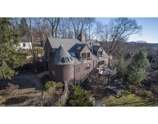 This shingle-style, circa 1889, wood-braced frame Carriage House sits high atop Aspinwall Hill. Originally the barn for The Otis Shepard House, 120 Rawson Road was designed by prominent Boston Architects, Hartwell and Richardson. With a spacious floor plan; complimented by luxurious contemporary features, breathtaking details abound, including an interior ramp, stunning horse stalls, a steep gable roof with skylights, an engaged turret, with a conical roof and cathedral ceilings. The oversized double doors at the entrance to this home were originally used for the horse drawn carriages.  Modern touches in the sixty-three hundred, and thirteen square feet of interior space include two kitchens, five zones of heat, and four zones of central air, hard wood, including mahogany in the study, and gorgeous cabinetry. The lot encompasses twenty-five thousand, one hundred and forty square feet of land where one can host parties under the stars or imagine horses grazing.