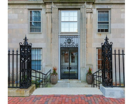 """Situated on the desirable Flat of the Hill, this 4th floor, 3+ bedroom, 3 bath condominium is in a 1927 elevator building. The generously proportioned living room w/fireplace is filled with light & amazing views of the Charles River & MIT. Another fireplace & china cabinet grace the banquet-sized dining room w/river views. The adjoining pantry passes into a vintage kitchen, w/adjacent """"maids' room"""" & full bath. The library (or bedroom) has a fireplace, walk-in closet, & built-in bookcases.  A generous master bedroom has 4 closets & original en suite bath. In addition, there are 2 bedrooms & a family bath. The wide hall provides a gallery-like reception area. This unique property boasts views, elegant period architectural detail & a sought-after location that's rarely available. With 2,060 sq ft, customize the space for spectacular one-floor living.  The professionally-managed building is close to shops, restaurants, Charles Street, the Public Garden, the Charles River & transportation."""