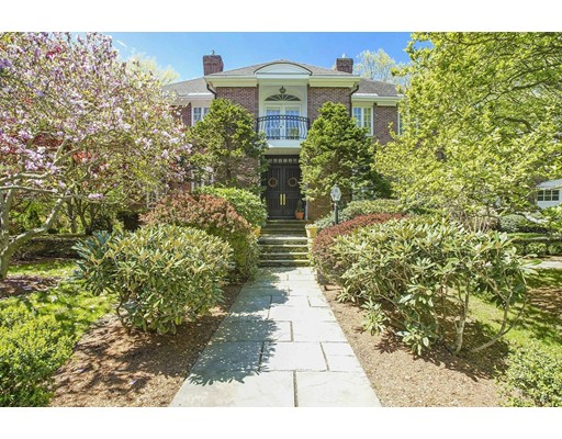 """Exceptional location and design cannot be overstated when describing this custom home on a cul-de sac, in the heart of Old Chestnut Hill. Residents can """"have it all"""" with the advantages of newer quality construction surrounded by the beauty of a historic neighborhood. With easy access to Boston, returning home to gardens & abutting conservation land provides a tranquil oasis. Inside, the two story foyer and sweeping staircase welcome visitors. 12' ceilings and floor to ceiling windows offer natural views and abundant light. An open floor plan allows easy flow for indoor/outdoor entertaining. Gas fireplaces, built-ins, and a generous chef's kitchen make this home ideal for parties or everyday life. A large apartment with kitchenette over the three-car garage is perfect for guests, au pair or in-laws. Outstanding public/private schools, convenient access to golf, tennis & fitness, T-Green Line, and Chestnut Hill shopping, add to the appeal of this wonderful home and its superb location."""