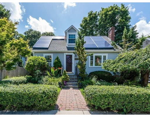 Come and visit one of Boston's Best Neighborhoods, Fairmount Hill!  This expanded cape on a quiet side street has it all, inside and out! Bright sunlit living room with wood burning fireplace and bay window, open floor plan dining/kitchen area with custom designed mahogany built-in, A granite topped center island to match counters, plus stainless appliances.Cozy entryway/mudroom...extra space we all love.  The first floor den/bedroom has french doors leading to upper deck overlooking magnificent back yard pool area.  There are 2 bedrooms on the second level, including an en-suite Master with a custom designed tile shower and gas fire place. This property abuts a private drive in Milton offering you quiet enjoyment by the pool.  Many system updates including, Heat, HW,  Electric and roof!  Close to recreation, biking, hiking, shopping and transportation.    Commuter rail at bottom of hill...just 20 minutes to downtown.