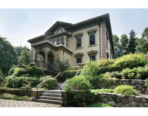 Circa 1875 and on the National Register of Historic Places, this spectacular Italianate estate is set in prestigious Chestnut Hill on top of Waban Hill Road with spectacular views of Boston. Impeccably and tastefully renovated yet respectful preservation of original details such as the glorious stair case, moldings, high ceilings, over-sized windows, and stained glass, this phenomenal residence features seventeen rooms including seven bedrooms, six full and two one half-bathrooms. An expansive, wrap-around terrace overlooks the beautiful and impressive grounds. Outstanding amenities abound: three-car garage, updated systems, security, separate guest or au pair wing, and charming seven-room carriage house.