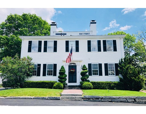 """Known as """"The Parsonage"""" in Manchester-by-the-Sea, built in 1812, this elegant four bedroom federalist colonial with a bonus in-law apartment will delight you. This is a once in a lifetime opportunity to own .8 beautifully landscaped acres in the village. This home is located in short walking distance to the center of town, the MBTA train and local shops, restaurants and Singing Beach. It is footsteps from Manchester's Fourth of July parade. Beautiful hand-painted wallpaper and Georgian style decorative floor welcome guests in a gracious center hall. High ceilings, period detail, glorious fireplaces and wide pine floors throughout main residence. Updated kitchen with Sub zero fridge, Wolf oven. Bonus barn. Sunny in law apartment two floors - generously sized, with its own living/dining room, kitchen and family room, two 3/4 baths and upstairs bedroom with laundry. Perfect for office/study or rental income opportunity."""