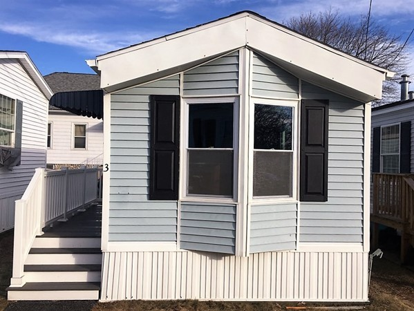 Southcoast Community Mobile Home Park comprised of 25 units is quiet, clean, well-maintained, professionally managed w/easy access to amenities!!! Owners must be 55+. Unit 3 consists of 408 sq ft of living space offering an open kitchen/living room area with breakfast bar! THIS MOBILE HOME IS PRACTICALLY BRAND NEW: roof & gutters (Feb 2019), newly remodeled kitchen w/honey maple cabinets (Jan 2019), new heating system (2016), many electric & plumbing updates (2016-2019), remodeled bathroom (2016), replacement windows (2013), front & back Trex porches! You deserve easy living in your Golden years...much more affordable than apartment living, independent from noisy tenants, maintenance free & extremely low utilities in this cozy & charming home! $440/month HOA covers water, sewer, real estate taxes, lawn maintenance, snow removal & trash removal. 1 assigned parking space located directly in front of your unit & additional visitor parking at rear of complex. Only service dogs are allowed.