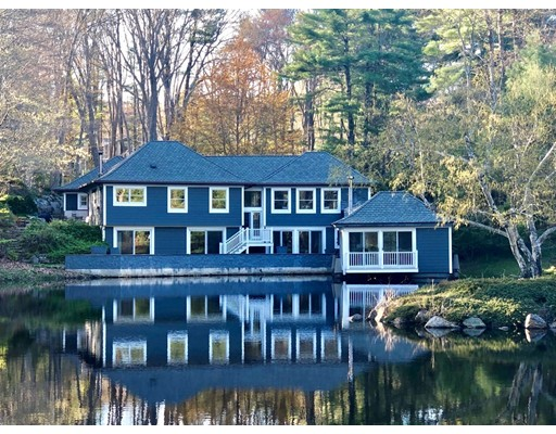 This is a Unique, charming Contemporary style house designed and built in 1980 by a Nautical  Engineer. It is entered at Street grade and the lower level is at pond grade with a Library/study/ that extends into the pond. There are three bedrooms with two baths, one en suite with the Master bedroom, a utility room and laundry on the lower level opening to the broad deck overlooking the pond with sliders to the deck.  On the entry level is a front hall , off which is a powder room, large living room, with a stairway to the Pond Room, a formal dining room, state of the art gourmet kitchen with a breakfast nook, an office, family room with bath, a mud room and access to the two car garage with a workshop. The plantings and gardens reflect a charming secluded feeling of enchantment with small patios and creative outdoor lighting. The property has been landscaped with numerous traditional oriental and eastern trees, shrubs and gardens all carefully laid out to embrace the house and pond.