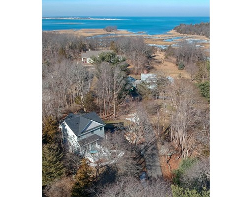 Set on a knoll on the dramatic rocky coast of Essex Bay, a stunning 2 bedroom craftsman style colonial is just a stone's throw to the water's edge. Take your kayak down the footpath or just enjoy the ocean breeze on the deck. This 2018 construction (on an existing foundation) has amazing high end finishes and hardwoods. This sun lit open floor plan living space is adorned with french doors and stylish color schemes. Gourmet chef's kitchen with marble countertops, center island, upgraded faucets, pot fillers, 5 burner cooktop, a walk in pantry provide great work space and ample storage. The 2 full bathrooms, one on each level have magnificent tile work and waterfall accents make you feel like you are in the pages of a magazine. Cathedral ceilings in the master with attached bath with an oversized shower and glass doors. There is also a second bedroom, access to attic for storage and the laundry. All the benefits of new high efficiency systems, appliances and fixtures. Come make it home!