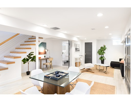 22 White Street Place Residences, built in 2004 with renovations completed in 2018, are three luxury three-bed, 3.5 bath single family style homes in Porter Square that define  contemporary living. Close to Davis Square, Harvard University and downtown Boston, the location of these homes is a commuters dream. Each unit features  detailed high end finishes including white oak flooring, Porcelanosa fixtures and Scavolini cabinets. An inviting first floor level offers open concept living and  dining equipped with a gas fireplace. Kitchens are fully-outfitted with Thermador appliances and quartz countertops. On the second floor, each home  features two spacious bedrooms and a full bath. The third floor hosts the master bedroom suite with a spacious private deck, walk-in closet and a master  bathroom, fitted with a freestanding tub and luxurious shower. The finished lower level makes an ideal media or recreation room. The residences come complete with one parking space.