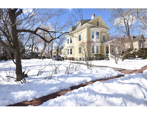 On over 1/3 of an acre, approximately 1 mile from Harvard Square, is this grand Victorian home on one of the loveliest streets in Cambridge. A gracious foyer features a curved staircase inviting you to living spaces that include a 34 ft living / dining room with two bay windows, fireplace and built-ins; family room with built-ins & bay window; eat-in kitchen with a bank of south facing windows looking out to the rear yard. The 2nd floor offers a lovely master suite, 2 additional bedrooms both with bay windows, study with built-ins, hall bathroom & laundry room. The top floor has a 2 bedroom apartment with separate entrance ideal for long term guests or a home office. The finished lower level contains a media room, game room & guest room with bath. NO INTERIOR PHOTOS TO RESPECT TENANTS PRIVACY. Property in very good condition.