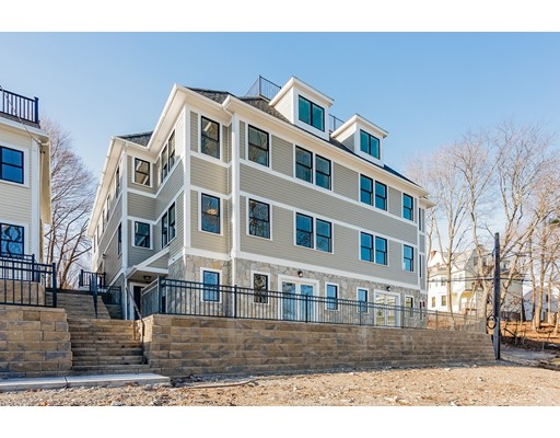 """Welcome to """"The Residences of Poplar Hill"""". Four new construction townhouses set on almost an acre of land w/ stunning views of Boston.This unit consists of 2 levels of living, w/ 6 rooms, 3 beds, 2.5 baths & 2,034 sf of living space. Stunning gourmet kitchen w/ white shaker cabinets, Quartz waterfall counters, tiled back-splash high-end appliances. First floor has open floor plan that opens up to a private stone patio w/ views of Boston and the large front yard. Phenomenal master suite, w/ large master bath w/ custom walk-in shower, double marble vanity.Other features include recessed lighting, high ceilings, hardwood flooring, central air, modern lighting fixtures. Exterior features include Hardie plank & stone veneer siding, maintenance-free vinyl decking & railings. 2 off-street assigned parking, energy-efficient furnaces, water heaters, and appliances. Located just steps from Roslindale Village shops, restaurants, &commuter train to Boston.Complex driveway is located on Kitterege"""