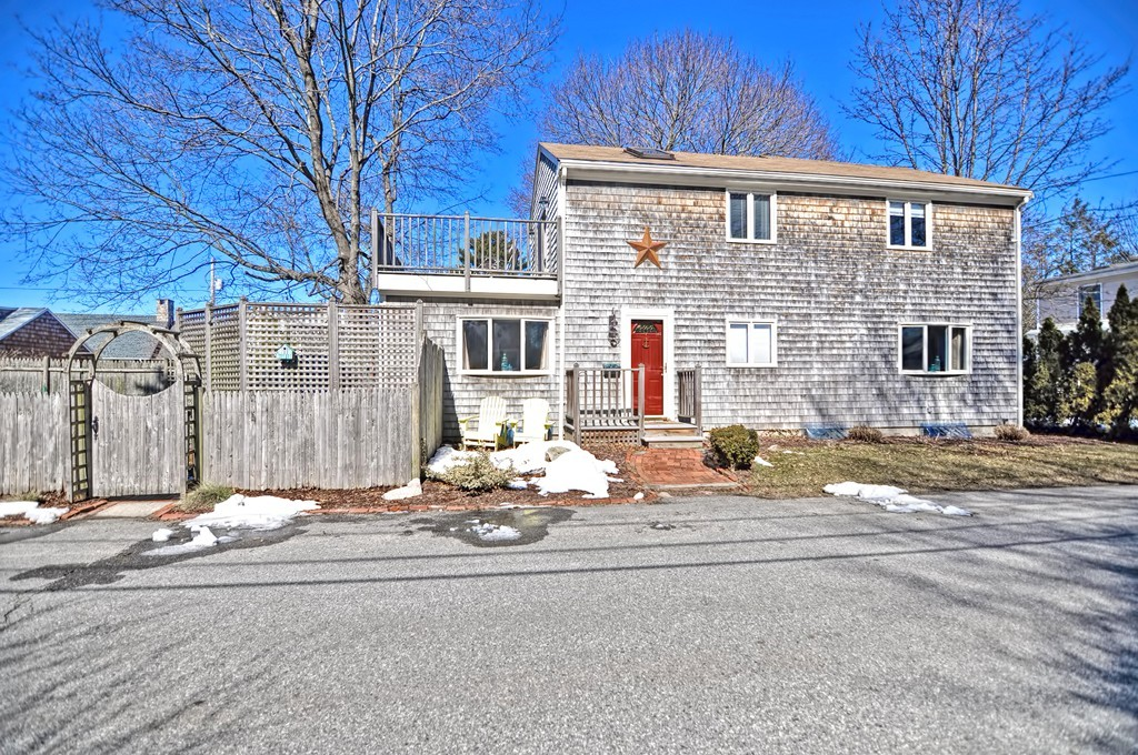 OPEN HOUSE CANCELED DUE TO ACCEPTED OFFER. The home you have been waiting for just hit the market! This gorgeous and meticulously maintained Hampden Meadows Colonial awaits and has it all! Enjoy water views of One Hundred Acre Cove from your rooftop deck and enjoy cooking in your white, fully updated granite kitchen! Main level is open and bright with a nice circular flow. The large 20 x 13 family room has a gas fireplace and bay window and is open to the kitchen area. Sparkling hardwood flooring is featured throughout the entire main level and most of the second. Each bedroom has soaring cathedral ceilings with beautiful exposed beams and stained wood which add character and warmth to every room. Master bed with skylights and french doors leading to balcony!
