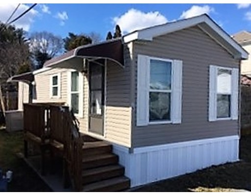 Southcoast Community Mobile Home Park, a 55+ community, is comprised of 25 units. The park is quiet, well-maintained & professionally managed!  Located in the north end of NB with easy access to amenities!!! Unit #15 consists of 616 sq ft of living space offering an open kitchen/living room area, spacious bedroom w/double closet, bathroom has a walk-in shower! Appliances are included in the sale: frig, range, microwave, dw, stackable w/d! This welcoming mobile home is move-in ready (built in 2010). Other features include high ceilings w/ceiling fans, alarm system and storage shed! You deserve easy living in your Golden years...much more affordable than apartment living, independent from noisy tenants, maintenance free & low utilities! $440/month HOA covers water, sewer, real estate taxes, lawn maintenance, snow removal & trash removal. Assigned parking space located directly in front of your unit & additional visitor parking at rear of complex. Only service dogs are allowed.