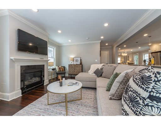Stunning masterpiece home just renovated for 2019! Located only steps to West Roxbury's Centre St with fine shops, restaurants & the commuter train to downtown Boston. This showstopper offers 2,350 SF of thoughtfully designed space that feels like a single family home with the carefree lifestyle of condo living! Two gorgeous levels of living space offers the perfect balance of grand entertaining areas with quiet intimate rooms for everyday living! Much thought given to design and detail, which makes this home a perfect blend of modern taste and classic architecture. The Grand kitchen features custom white cabinetry, quartz counters, 8 foot island & six burner Jenn-Air gas stove. The floor plan has a wonderful flow including the kitchen overlooking the family room & outside private deck. All bathrooms have designer tile work! Complete gut renovation inside and out compares favorably to new construction! All new: wiring, plumbing, exterior, roof, windows, HVAC & porches! One car garage!!