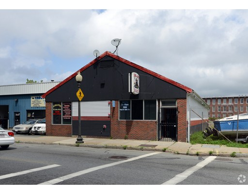 Opportunity Knocks! Free Standing Commercial Building with abutting 8,674 square foot lot! High Visibility and easy access via Route 18(south) by taking the Weld Street exit. Located just west of the right of way for the Freight/Proposed Commuter Rail Line!  Main level has 3420 square feet and full basement. Interior needs completion. There is 2 x 4 studs on first floor and basement with a heating unit installed This includes first floor electrical, sheet rock, bathroom plumbing fixtures & ceiling tiles.Priced Well below the assessed value of $354,000. Call Today!
