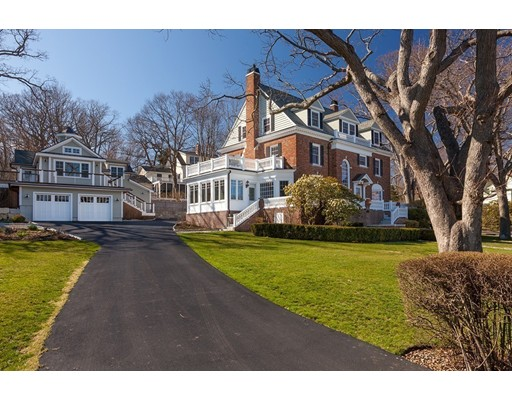 Reminiscent of grand country estates, this stately home masterfully combines exquisite Old World craftsmanship and 21st Century technology in a stunning setting where 113-year-old oak trees guard the fully renovated 1896 Rockport gem. Originally an inn, this home is surrounded by lush gardens, sprawling lawns and amazing views. Period details like quarter-sawn, parquet oak floors with intricate mahogany inlays, sumptuous mill-work and 3 working fireplaces blend effortlessly with a contemporary huge custom chef's kitchen with a Wolf six-burner gas range and massive granite-topped center island. An inviting 4-season sun room with colorful Mercer tiles, fireplace and pool house with a full kitchen and bath pay homage to artisans past and present. An outdoor stone fireplace and pergola is adjacent to the heated saltwater pool. A superbly maintained exterior and new systems such as the  GE generator, windows, electric, furnace and heated garages, this gorgeous home awaits its next steward.
