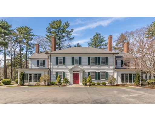 Elegant estate privately sited on 14 acres abutting audubon land. Accented with established perennials, mature trees and a pond   This beautiful property seamlessly blends the charm and character of circa 1910 craftsmanship with numerous architectural updates ideal for today's living and entertaining.  The Living Room, Dining Room and Den are accented with magnificent crown moldings, decorative chair rails, wood floors, built in bookcases, and mantled fireplaces.  A sunroom  opens onto a blue stone patio with stone walls overlooking the pond and lawn.  The renovated open concept Family Room, breakfast room and gourmet Kitchen features two fireplaces,  unique coffered ceiling with bead board, granite counters and island, stainless steel Subzero and Thermador appliances.  The adjacent original Mahogany Butler's Pantry adds both character and functionality,  The 3 car garage includes a second floor apartment. Enjoy all that Beverly Farms has to offer.