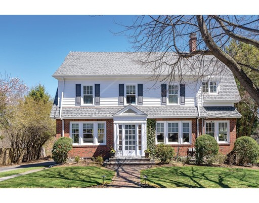 Spectacular sunrise views of the downtown Boston skyline are captured from this special South Brookline Colonial-style residence. Traditional style with modern features. Beautifully updated chefs kitchen with expanded dining area. Formal dining room, living room with French doors and direct access to a sun deck. Sunroom/office and lavatory complete the first floor. Three bedrooms, including a master bedroom with en suite marble bathroom and family bathroom are located on the second floor. The third floor has huge picture window, a large family room and a fourth bedroom with a full bathroom. There is garage parking for three cars and a great fenced play yard.