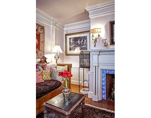 Built in 1900 and designed by renowned architect Lois Lily Howe, this sophisticated and charming Colonial Revival home in West Cambridge is located in the Gold Crown Historical District. Magnificent for large-scale entertaining, yet comfortable as a family dwelling, this architecturally refined three- story home has remarkable finishes that encapsulate its character. Crown moldings are original and have been cared for, gracefully cap the high ceilings and five fireplaces are found throughout, some of which are adorned with Antique Delft tile. This home is equipped with seven spacious bedrooms, with three located on the second floor and four on the third floor & four and a half baths. One of the many features tied to the location of this home are the superb views of the park and Charles River from the south side. A separate entrance to the home takes you into a private garden space, a hidden oasis from the bustling streets of Harvard Square just a few blocks away.
