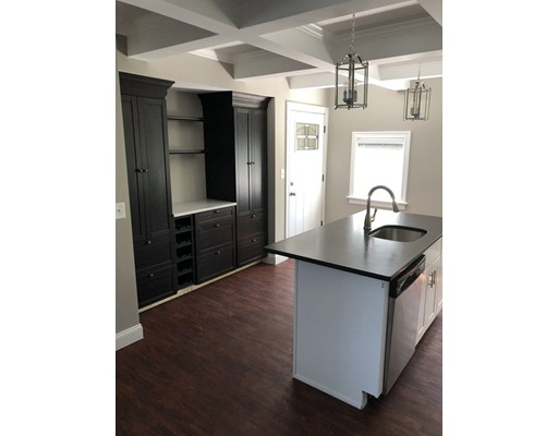 This newly renovated apartment is located minutes away from the commuter rail and T bus stops, restaurants, laundromats, golf course, parks, shops, and more!  Ideally situated on a dead end street in a quiet neighborhood, the unit features an open floor plan, custom shelving, and in-unit laundry.  Also includes two off-street parking spaces. No pets or smoking allowed. Available now!