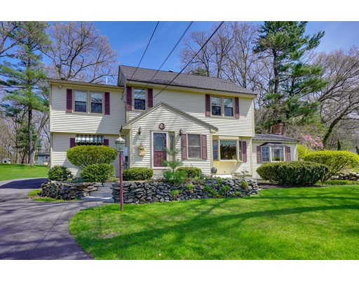 Warm and inviting (100% rebuilt in 1987) center entrance colonial with park-like grounds and wonderful curb appeal. The home flows nicely as you enter with an estate like foyer, open floor plan, and spacious room sizes. The large kitchen was built for entertaining,  island has seating on both sides. Family room area has a warm and comforting feel with a beautiful stone fireplace and walks out to a charming patio area out back. Two incredible front to back bedrooms on the second level, both with separate walkout balconies overlooking the grounds. Master bath also equally impressive in size. Large 1st floor BR can also double as a second MBR.  Walkways take you out back to the immaculate, irrigated grounds and large center stone water feature with fountain. Endless outside open space for multiple uses and large outbuildings, perfect for additional storage, work, pets, or play. The back side of the updated roof has 37 owned solar panels to help reduce electric costs all year long.