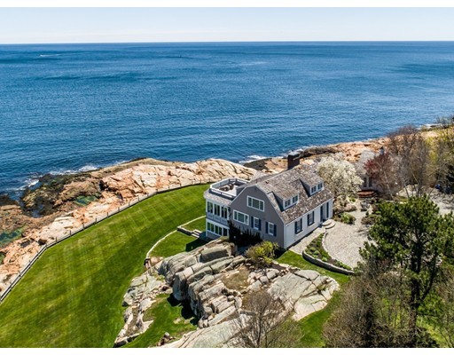 Commanding the tip of magnificent Mussel Point, the ancient headland marking the entry to Gloucester Harbor along with opposing Eastern Point, this sprawling 1.5 acre oceanfront property provides a spectacular setting for the finest in seaside living and entertaining. The splendid, sun-drenched 3,800+ sf residence offers sweeping views of the harbor, Eastern Point Light, and the endless parade of sailboats, yachts and fishing vessels passing to and from the Atlantic. The open and flowing interior has the feel of being aboard a luxury ocean liner, with cascading levels of ocean-facing living spaces equipped with deck access. The main level features two bedrooms; family room with fireplace and delightful four-season porch; and newly renovated chef's kitchen opening to a large deck with hot tub and bar overlooking the lawns and harbor, creating a perfect venue for unforgettable entertaining or simply the pinnacle of outdoor living.