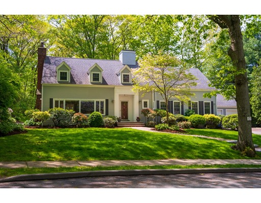 Set on one of S. Brookline's most captivating tree lined streets, this home sits on a 1/2 acre of level lushly landscaped land. It boasts a flexible open floor plan and meticulous renovations. 1st fl. offers gracious fireplaced living room with built-in bookshelves and lovely dining room with French doors to patio. Oversized kitchen has top of the line appliances, island with farm sink and eating area overlooking grounds, and it opens to adjoining family room. Second large family room with full bathroom could be a 1st fl. master suite. 1st fl. also has another full bath and two bedrooms, now used as office and exercise room. 2nd fl. highlighted by fabulous master suite with 2 walk-in closets, luxury bathroom and private sitting room. There are also 2 good sized bedrooms, a full bath, and large laundry room on 2nd fl. 2-car direct entry garage and mudroom. Stellar location, on quiet street close to Baker School. Easy access to Chestnut Hill shops, T, private schools and medical centers.