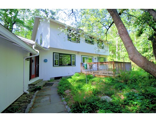 This wonderful home has a good soul!  Set back from the road surrounded by pretty views, this sun-filled contemporary colonial is filled with delightful surprises.  The home boasts an absolute dream kitchen with commercial grade appliances, an abundance of cabinets and granite counter tops, the kitchen was designed for the serious chef.  The open floor plan allows for great entertaining, the fireplace living room flows easily into the dining room, the first floor also has a cathedral ceiling family room and a   first-floor den with a private full bathroom and a fireplace. The second floor has 4 corner bedrooms that include a master suite with its own private bathroom. The house is ideal for anyone who wants a really wonderful home and a fantastic community filled with great opportunities, easy commuting options, and top schools! This special property was worth waiting for!
